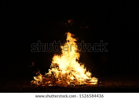 Bonfire of Burning Wood Pallets on a Beach #1526584436