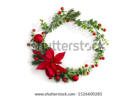 Christmas decoration. Frame of flower of red poinsettia, branch christmas tree, balls, red berry on a white background with space for text. Top view, flat lay #1526600285
