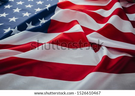American flag waving in the wind. Flag USA as a patriotic background #1526610467