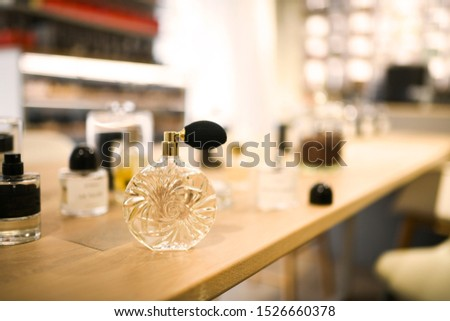 Set of perfumes on the table. Sensual, delicate scents to choose from. Banner for training and beauty workshop. #1526660378