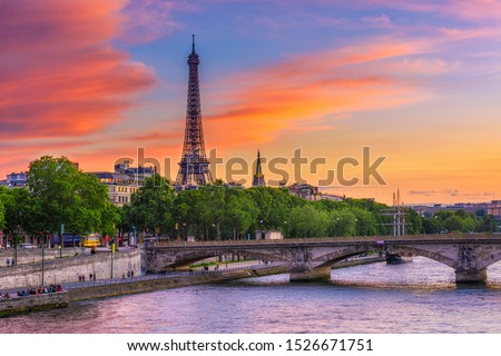 Sunset view of Eiffel tower and Seine river in Paris, France. Eiffel Tower is one of the most iconic landmarks of Paris. Cityscape of Paris Royalty-Free Stock Photo #1526671751
