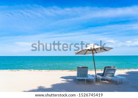 Beautiful umbrella and chair around beach sea ocean with blue sky for travel vacation #1526745419