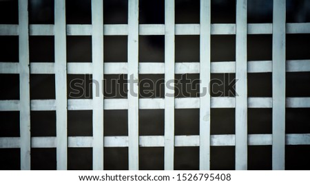 Classic background of white grid pattern fence.