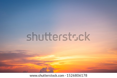 Beautiful sky painted by the sun leaving bright golden shades.Dense clouds in twilight sky in winter evening.Image of cloud sky on evening time.Evening sky scene with golden light from the setting sun #1526806178
