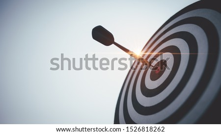 Bullseye is a target of business. Dart is an opportunity and Dartboard is the target and goal. So both of that represent a challenge in business marketing as concept. #1526818262