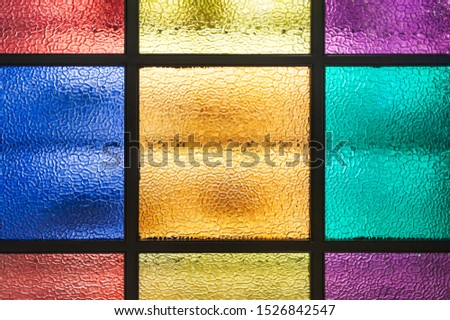 Decorative window of various colored rectangles with light coming through #1526842547