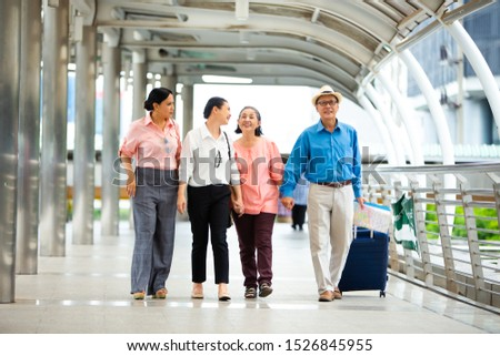Travel and tourism concept.Group of senior people traveling in the city and looking the map in hand for Shopping Mall Search #1526845955
