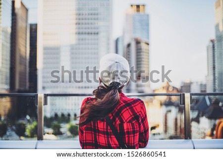 Traveler woman looking at the city #1526860541