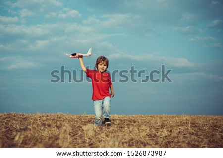 Childhood memories. Active leisure with kids. Kid pilot having fun on meadow. Summer leisure. Cherishing memories of childhood. The concept of child kindness and childhood Royalty-Free Stock Photo #1526873987