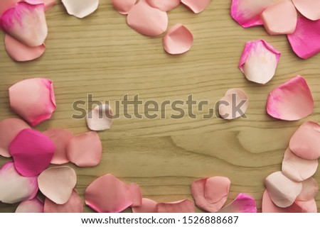 "rose petals made of papaer frame on wood background  (""Les fleurs sont belles"" is ""Flowers are beautiful""in French"" ) #1526888687"