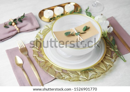 Elegant festive table setting on light background #1526901770
