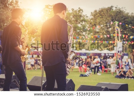 jazz musician playing outdoor concert Royalty-Free Stock Photo #1526923550