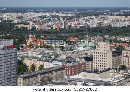 Warsaw, Poland - August 2nd 2019 - capital and largest city of Poland, Warsaw is a modern town which was completely rebuilt after WWII. Here in particular a glimpse of its residential architecture #1526927882