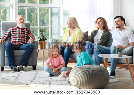 Big family watching TV together at home #1527045980