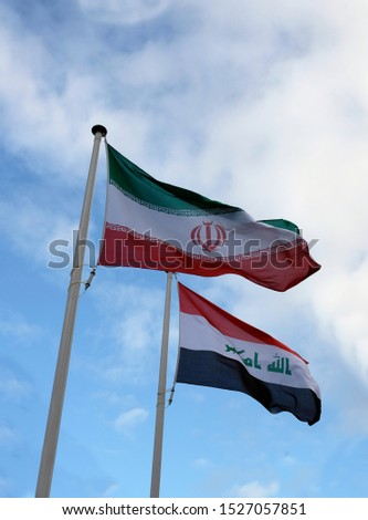 National flags of Iran and Iraq waving in the wind #1527057851