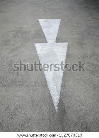 White arrow on concrete, arrow . #1527073313