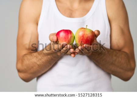 handsome man with beautiful apples in hands #1527128315