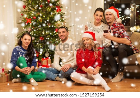 celebration and holidays concept - happy friends having christmas party together at home over snow #1527159254