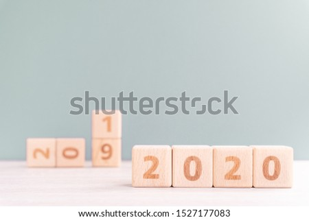 Abstract 2020, 2019 New year target plan design concept - wood blocks cubes on wooden table and pastel green background, close up, blank copy space. #1527177083