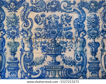 Traditional Portuguese, glazed ceramic tiles. Azulejo white, blue ornate pattern, for design, backdrop. Abstract background from old decorative painted tiles, religious theme with angels and flowers. Royalty-Free Stock Photo #1527213275