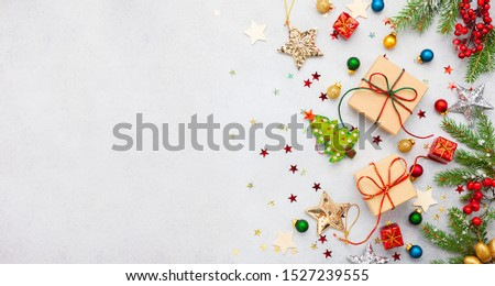 Christmas background with gift boxes, festive decor, fir tree branches and paper cards notes. Flat lay. Christmas and New Year concept. #1527239555