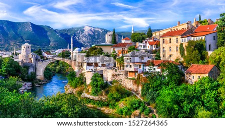 Amazing iconic old town Mostar with famous bridge in Bosnia and Herzegovina, popular tourist destination Royalty-Free Stock Photo #1527264365