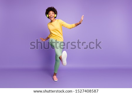 Full length body size view of nice attractive cheerful cheery crazy clumsy wavy-haired girl listening music having fun strolling fooling dancing isolated on violet purple lilac pastel color background