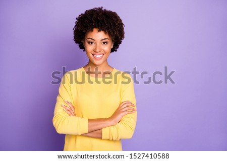 Attractive young representative of business people community standing confidently with arms crossed smiling toothily wearing yellow sweater isolated over purple pastel color background