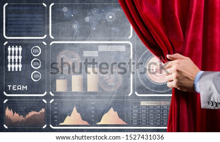 Hand opening red curtain and drawing business graphs and diagrams behind it #1527431036