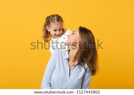 Woman in light clothes have fun with cute child baby girl 4-5 years old. Mommy little kid daughter isolated on yellow background studio portrait. Mother's Day love family parenthood childhood concept #1527442802