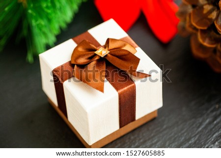 New year gift with christmas decorations on dark background #1527605885