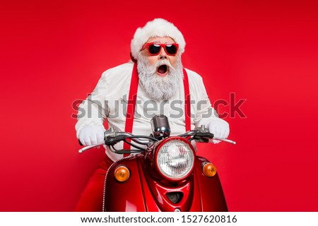 Portrait of nice attractive bearded crazy cheerful cheery funny funky Santa riding motor bike delivering shop orders hurry up isolated over bright vivid shine vibrant red color background #1527620816