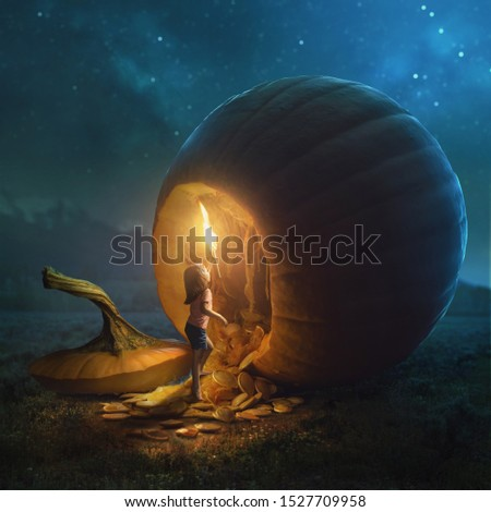 A young girl tries to go inside a very large pumpkin. Royalty-Free Stock Photo #1527709958