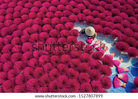 Aerial view of Incense sticks drying outdoor with Vietnamese woman wearing conical hat in north of Vietnam. Royalty high quality free stock image from above #1527807899