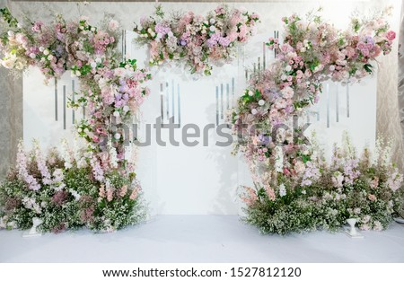 Beautiful wedding flower backdrop For taking pictures. Royalty-Free Stock Photo #1527812120