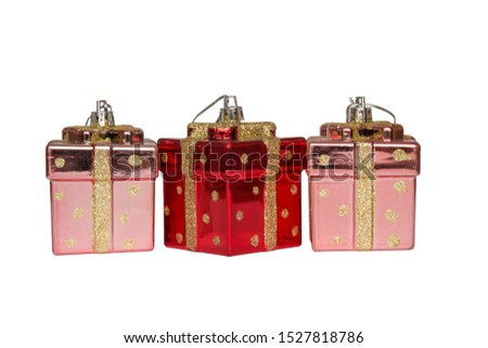 Christmas toys for the Christmas tree and new year, three beautiful red presents isolated on the white background. #1527818786
