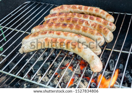 Hot grill with rostaed bratwurst #1527834806