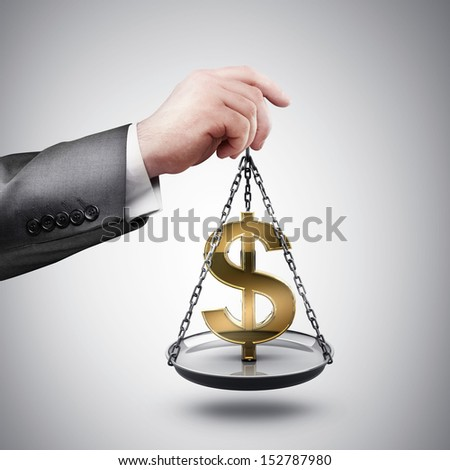 businessman hand holding Scale with symbols of currencies US dollar  #152787980