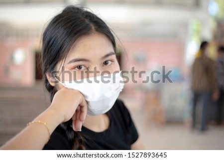 Women wearing masks to protect against germs and air pollution. #1527893645