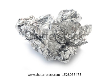 Crumpled Tin Foil Isolated On White #1528033475