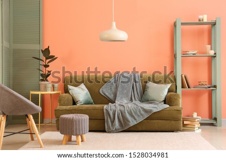 Stylish interior of living room near color wall #1528034981