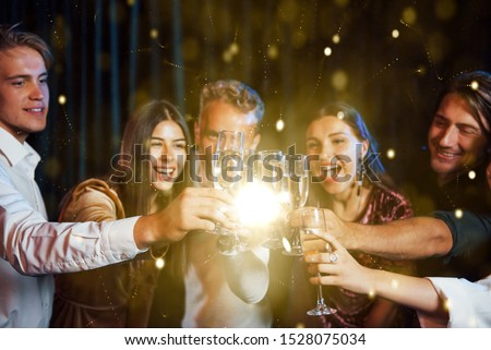 Group of cheerful young people have party and celebrating new year indoors. #1528075034