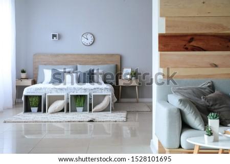 Stylish interior of modern studio apartment #1528101695
