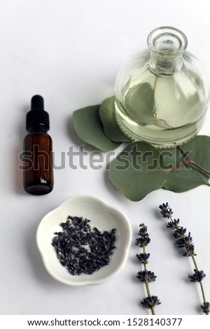 Natural aromatherapy and apothecary ingredients of lavender and eucalyptus on bright white background with bottles for spa, wellness, homeopathic, relaxation #1528140377