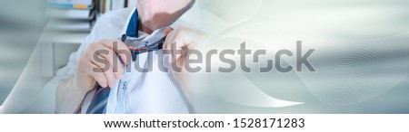 Businessman undoing his tie at office; panoramic banner #1528171283