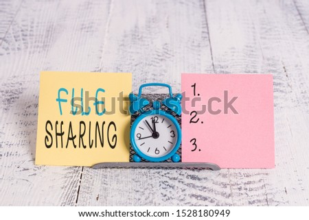 Text sign showing File Sharing. Conceptual photo transmit files from one computer to another over a network. #1528180949