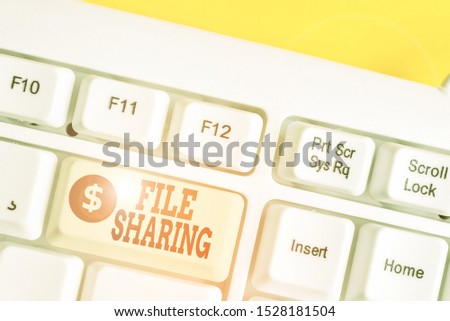 Text sign showing File Sharing. Conceptual photo transmit files from one computer to another over a network White pc keyboard with empty note paper above white background key copy space. #1528181504