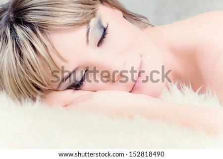 portrait of beautiful woman slipping on fur #152818490