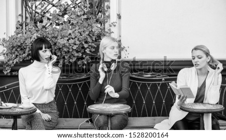 Group pretty women cafe terrace entertain themselves with reading speaking and listening. Information source. Female leisure. Hobby and leisure. Different interests. Weekend relax and leisure. #1528200164