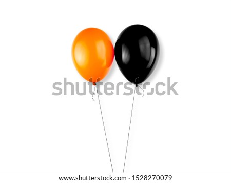 Orange and black colored balloons on a white background. Halloween elements, text and copy space. #1528270079